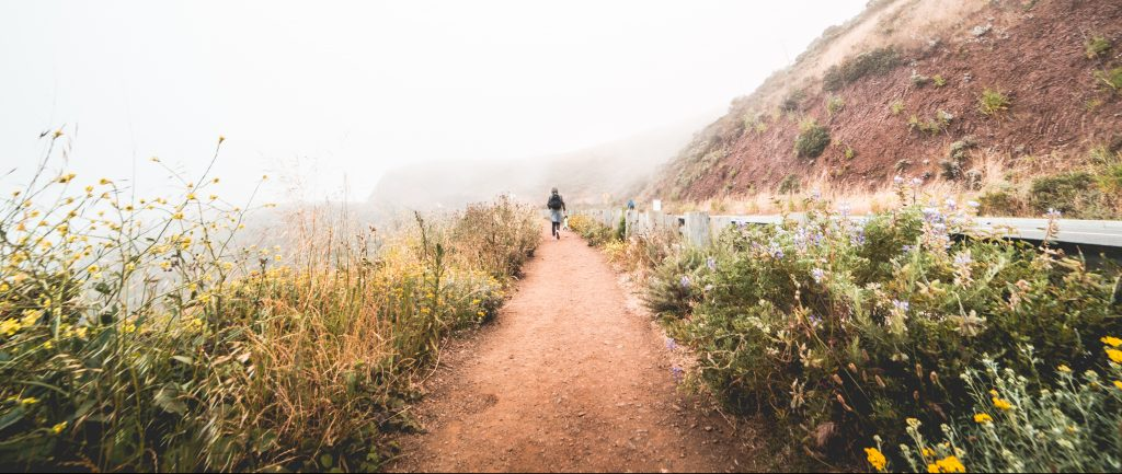 young-woman-hiking-the-mountain-trail-in-foggy-weather-picjumbo-com
